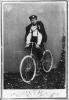 Un giovane ciclista posa in sella al suo prestigioso mezzo